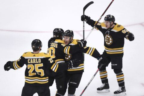 Early goals help lift Bruins past Maple Leafs 5-1 in Game 7