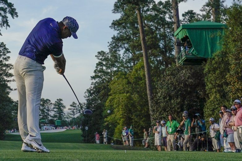 933a51b538ed6 Brooks Koepka hits on the 18th tee during the first round for the Masters golf  tournament Thursday