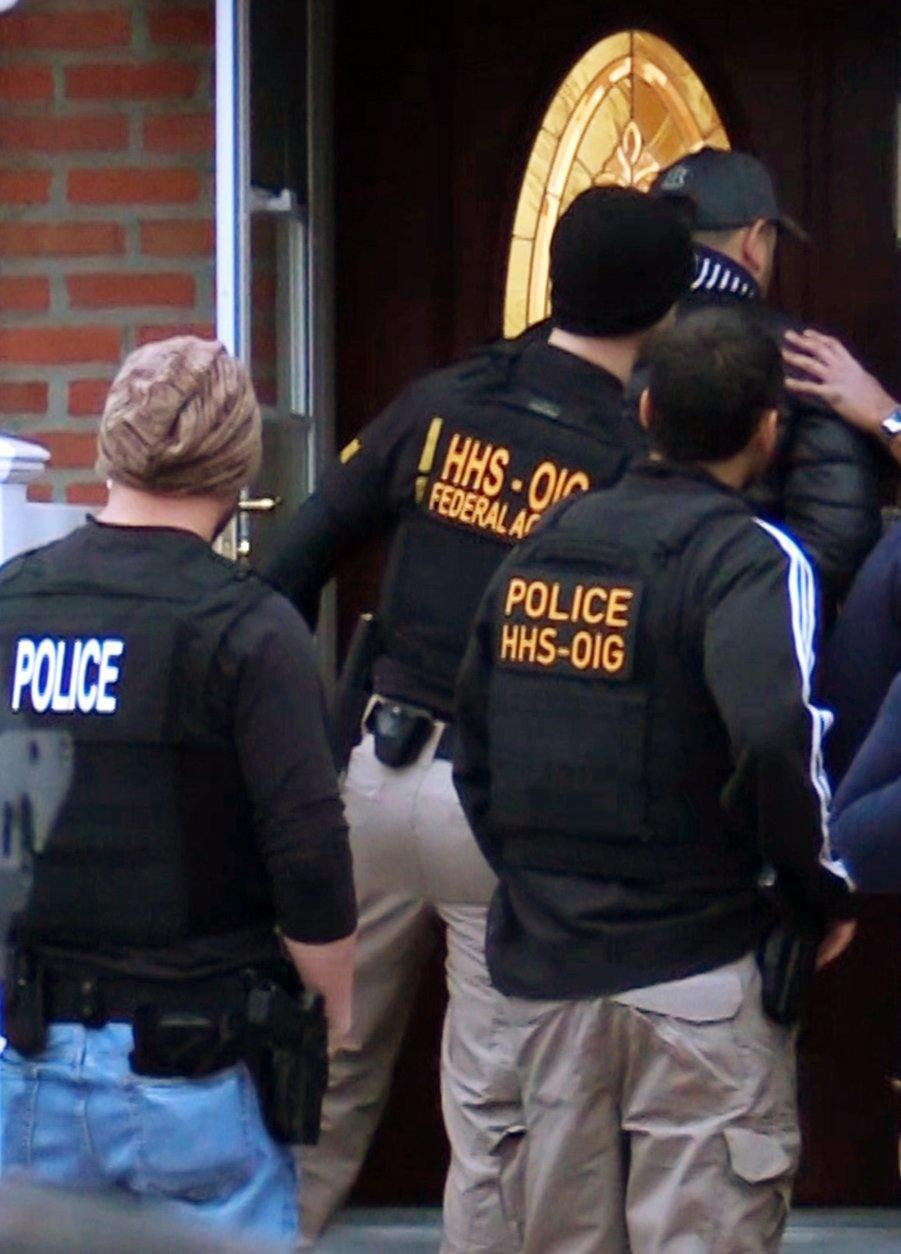 In this photo provided by the Department of Health and Human Services, Office of Inspector General, HHS Office of Inspector General agents, and other law enforcement officers, take part in arrests Tuesday, April 9, 2019, in Queens, N.Y., as they break up a billion-dollar Medicare scam that peddled unneeded orthopedic braces to hundreds of thousands of seniors nationwide, using a network of foreign call centers. (Department of Health and Human Services, Office of Inspector General via AP)
