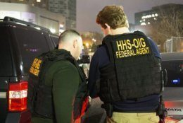 In this photo provided by the Department of Health and Human Services, Office of Inspector General, HHS Office of Inspector General agents, take part in arrests Tuesday, April 9, 2019, in Queens, N.Y., as they break up a billion-dollar Medicare scam that peddled unneeded orthopedic braces to hundreds of thousands of seniors nationwide, using a network of foreign call centers. (Department of Health and Human Services, Office of Inspector General via AP)