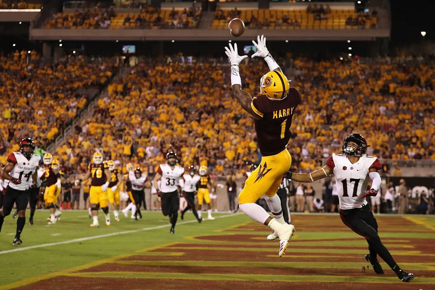 TEMPE, AZ - SEPTEMBER 09:  Wide receiver N'Keal Harry #1 of the Arizona State Sun Devils catches a five yard touchdown pass against cornerback Ron Smith #17 of the San Diego State Aztecs during the first half of the college football game at Sun Devil Stadium on September 9, 2017 in Tempe, Arizona.  (Photo by Christian Petersen/Getty Images)