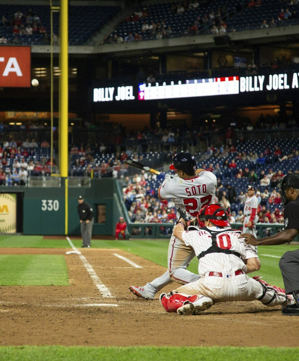 Washington Nationals' Juan Soto hits a three-run home run during the 10th inning of the team's baseball game against the Philadelphia Phillies, Tuesday, April 9, 2019, in Philadelphia. The Nationals won 10-6 in 10 innings. (AP Photo/Chris Szagola)