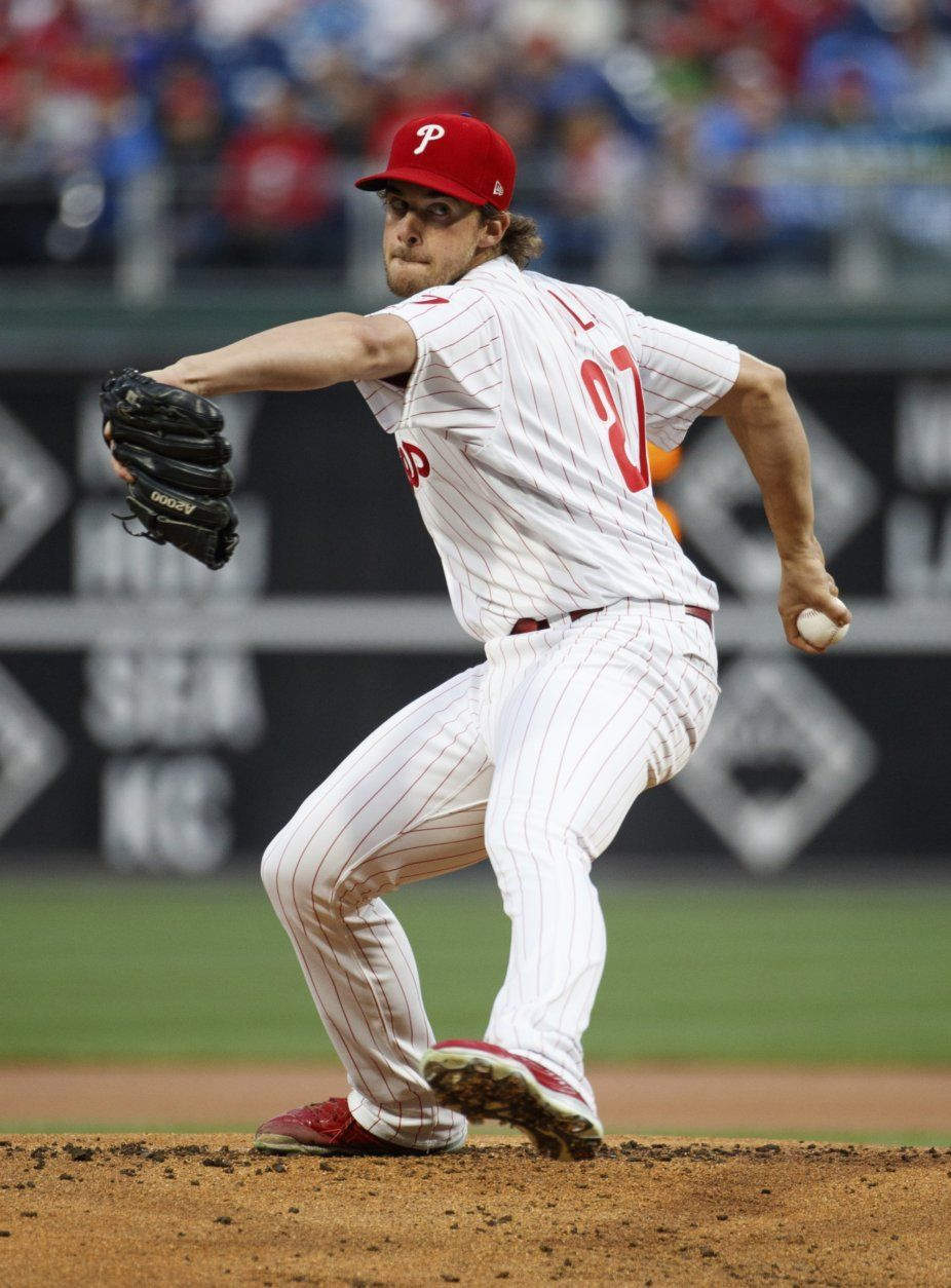Philadelphia Phillies starting pitcher Aaron Nola throws during the first inning of the team's baseball game against the Washington Nationals, Tuesday, April 9, 2019, in Philadelphia. (AP Photo/Chris Szagola)