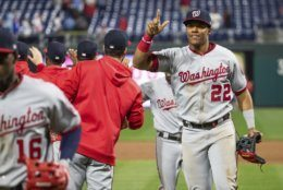 Washington Nationals' Juan Soto, right, celebrates with teammates following the team's 10-6 win over the Philadelphia Phillies in 10 innings in a baseball game Tuesday, April 9, 2019, in Philadelphia. (AP Photo/Chris Szagola)