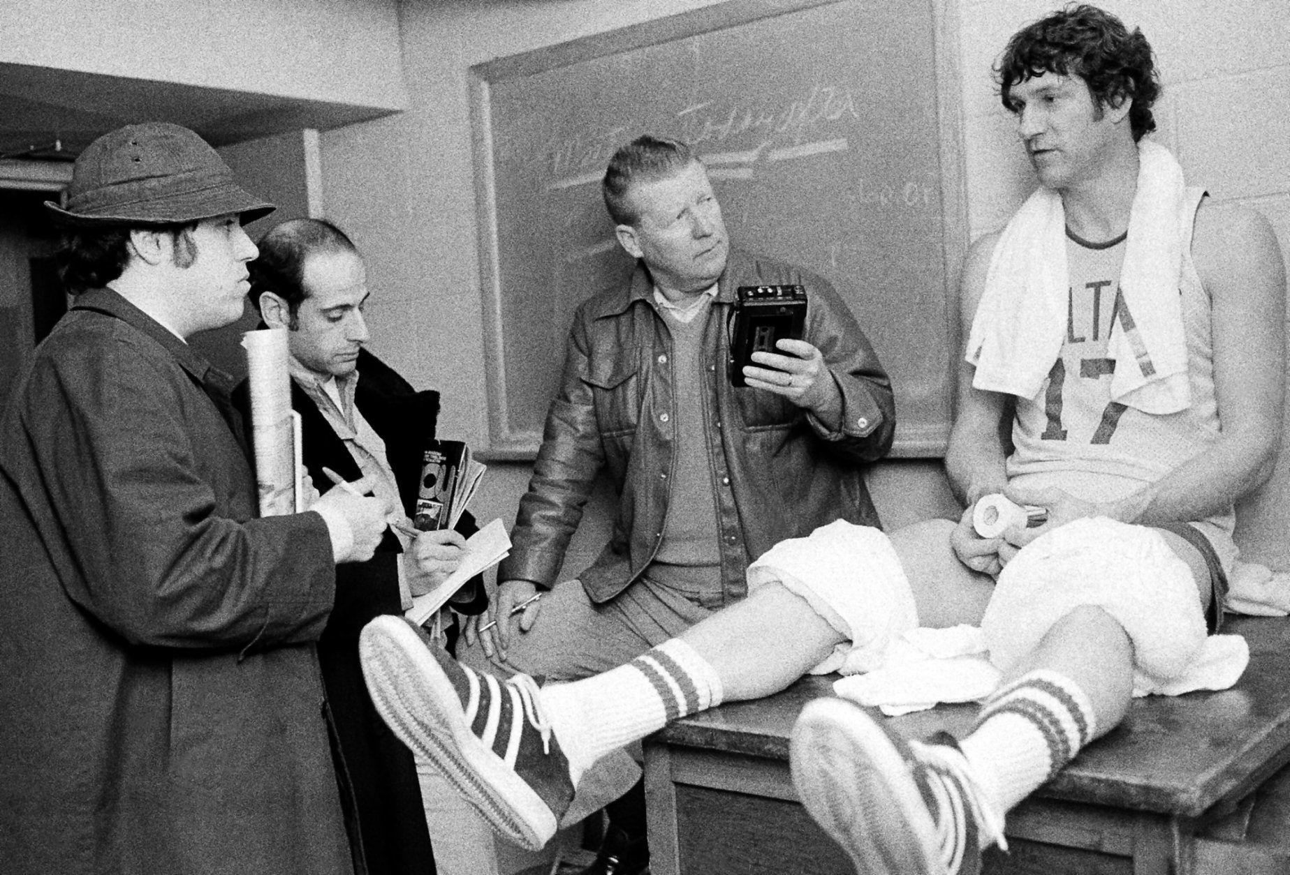 FILE - In this March 17, 1976 file photo, Boston Celtics' John Havlicek chats with newsmen after an NBA workout in Lexington, Mass. The Boston Celtics say Hall of Famer John Havlicek, whose steal of Hal Green's inbounds pass in the final seconds of the 1965 Eastern Conference finals against the Philadelphia 76ers remains one of the most famous plays in NBA history, has died. The team says Havlicek died Thursday, April 25, 2019 at age 79.  (AP Photo/ File)
