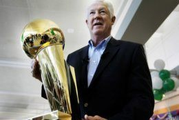 FILE - In this Wednesday, June 4, 2008 file photo, NBA legend John Havlicek holds the Larry O'Brien NBA Championship Trophy at Manchester Boston Regional Airport in Manchester, N.H. The Boston Celtics say Hall of Famer John Havlicek, whose steal of Hal Green's inbounds pass in the final seconds of the 1965 Eastern Conference finals against the Philadelphia 76ers remains one of the most famous plays in NBA history, has died. The team says Havlicek died Thursday, April 25, 2019 at age 79. (AP Photo/Cheryl Senter, File)