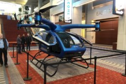 """Surefly's newest electric helicopter looks like an over-sized drone and is being dubbed the """"flying car"""" of tomorrow.(WTOP/Mike Murillo)"""