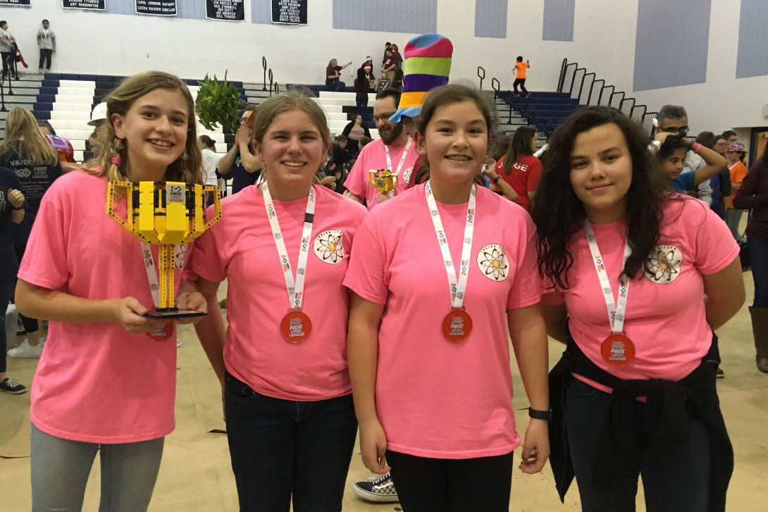 Fusion Four, the Grand Champion team from the Virginia-D.C. States Competition at James Madison University on Dec. 2, 2018: Devon Rudolph, Emma Hrabak, Minah Sisco, and Reira Erickson. (Courtesy Jo Hee Sisco)