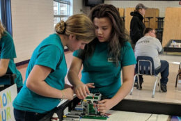 Emma Hrabak and Reira Erickson test their robot and program during a practice run at the Regionals Competition, held at Hayfield Secondary School in Alexandria, Virginia, on Nov. 18, 2018. (Courtesy Merrie Joy Hrabak)