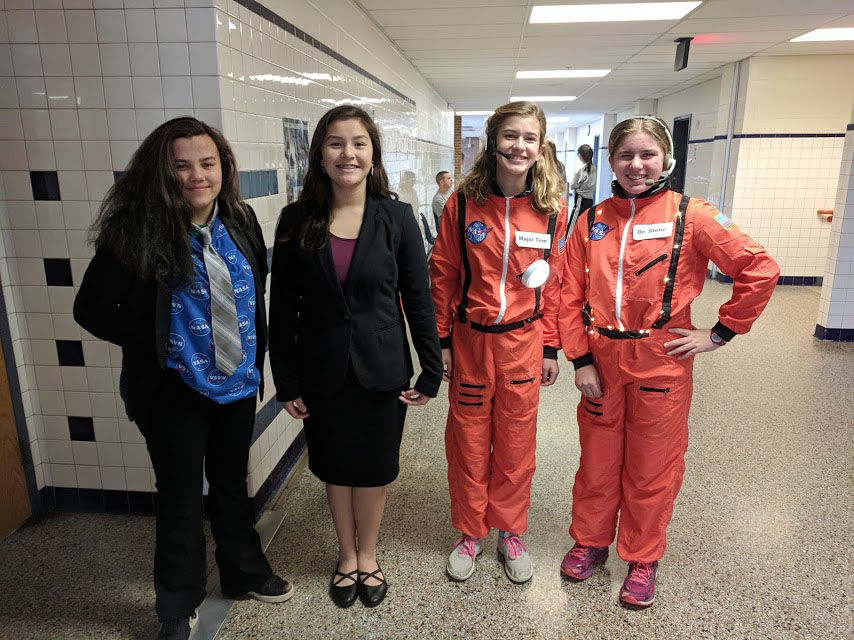 Reira Erickson, Minah Sisco, Devon Rudolph and Emma Hrabak used a skit to present the research project portion of their entry at the regional competition at Hayfield High School, in Alexandria, Virginia. The project assignment was to develop a safer system for astronauts conducting untethered spacewalks. (Courtesy Merrie Joy Hrabak)
