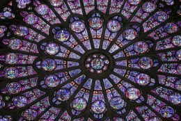 Shown is one of three famous stained glass windows from Notre Dame cathedral in Paris. (Patrick Kovarik/AFP/Getty Images)