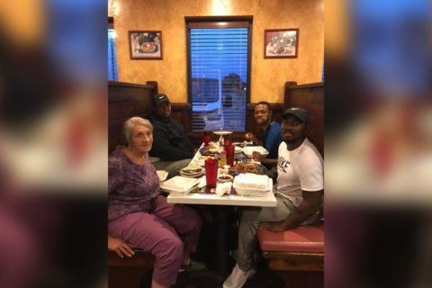 Men share meal with elderly widow in viral photo