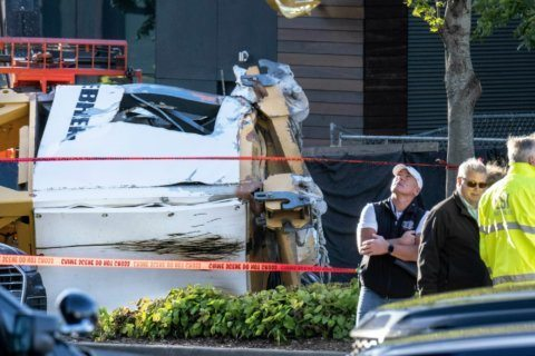 Seattle college says student was among those killed by crane