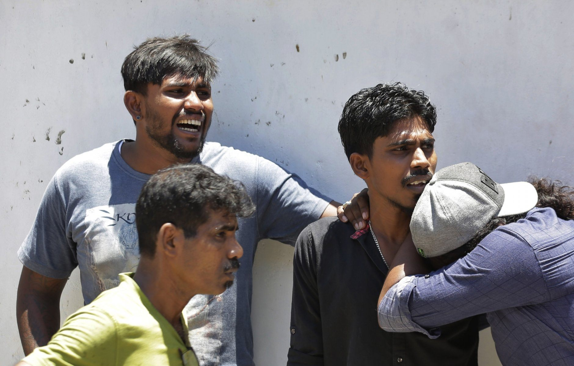 Relatives of a blast victim weep outside a police morgue in Colombo, Sri Lanka, Sunday, April 21, 2019. More than two hundred people were killed and hundreds more injured in eight blasts that rocked churches and hotels in and just outside Sri Lanka's capital on Easter Sunday. (AP Photo/Eranga Jayawardena)