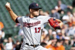Minnesota Twins starting pitcher Jose Berrios (17) throws in the first inning of a baseball game against the Baltimore Orioles, Saturday, April 20, 2019, in Baltimore. (AP Photo/Tommy Gilligan)