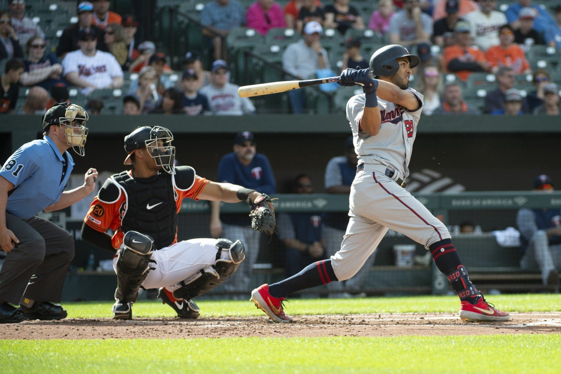 Minnesota Twins' Eddie Rosario, right, hits a solo home run in the second inning of a baseball game against the Baltimore Orioles, Saturday, April 20, 2019, in Baltimore. (AP Photo/Tommy Gilligan)
