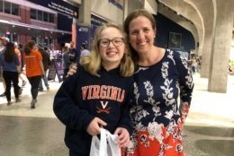 Angelique Wynkoop  and her 12-year-old daughter, Ellie, wait to welcome home the Cavaliers Tuesday, April 10, 2019. (WTOP/Kristi King)