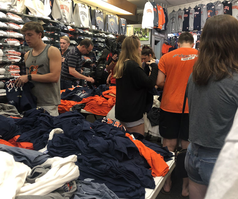 The line to get championship Virginia gear was long as fans anticipated the team's return Tuesday, April 9, 2019. (WTOP/Joslyn Chesson)