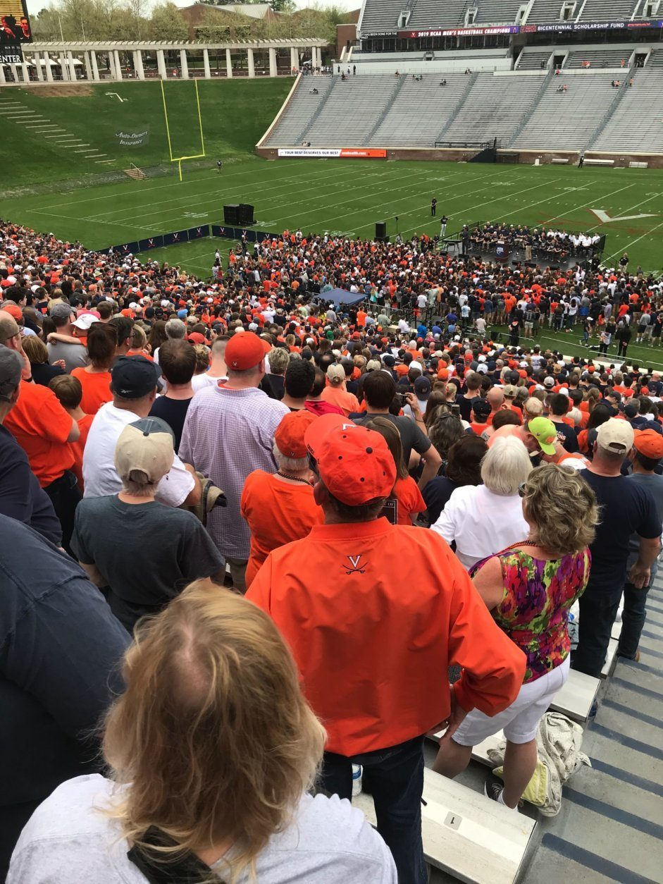 Fans gather at Scott Stadium in Charlottesville, Virginia, on Saturday, April 13, 2019, for a celebration for the men's basketball team. (WTOP/Michelle Basch)