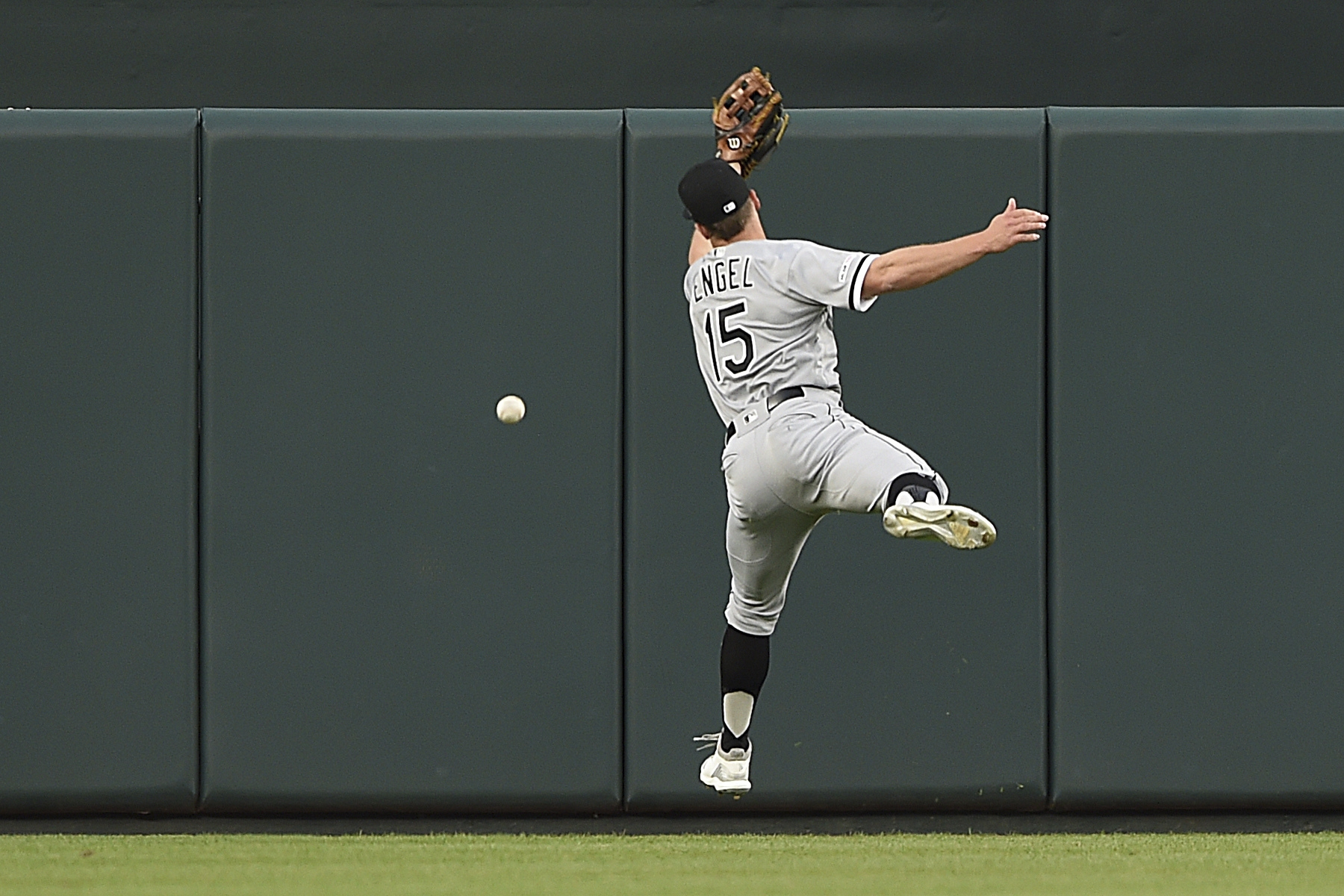 Chicago White Sox center fielder Adam Engel leaps but is unable to catch a fly ball hit by Baltimore Orioles' Dwight Smith Jr. in the first inning of a baseball game, Wednesday, April 24, 2019, in Baltimore. Smith Jr. earned a double on the play. (AP Photo/Gail Burton)