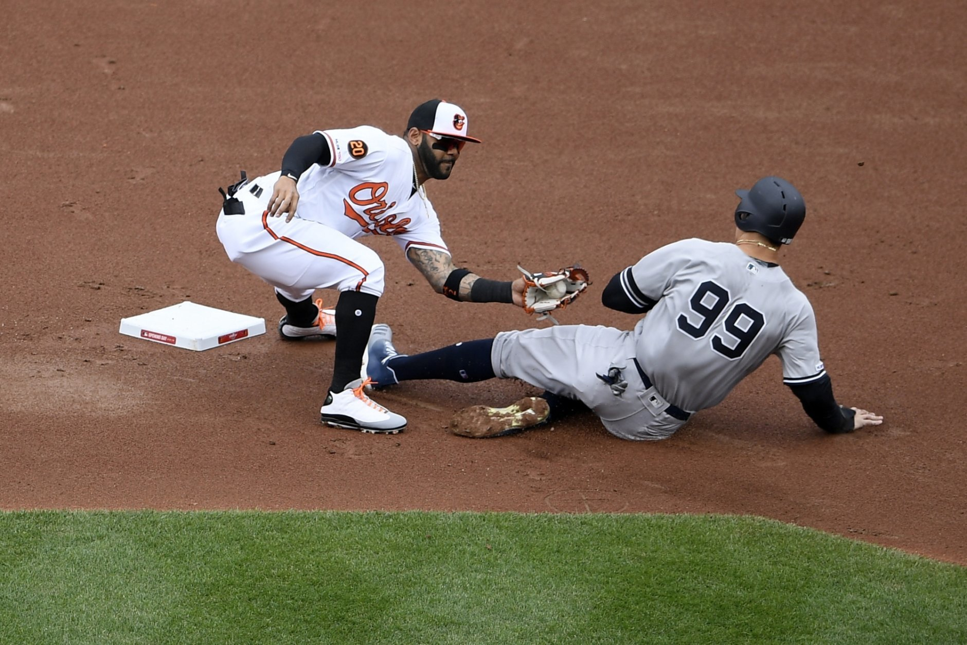 New York Yankees' Aaron Judge (99) is out trying to steal second against Baltimore Orioles second baseman Jonathan Villar, left, during the first inning of a baseball game, Thursday, April 4, 2019, in Baltimore. (AP Photo/Nick Wass)