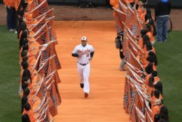 Baltimore Orioles manager Brandon Hyde (18) runs down the orange carpet during introductions before a baseball game between the Orioles and the New York Yankees, Thursday, April 4, 2019, in Baltimore. (AP Photo/Nick Wass)