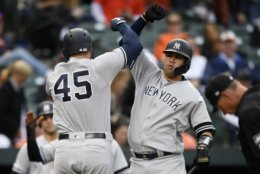 New York Yankees' Luke Voit (45) celebrates his three-run home run with Gary Sanchez, right, during the ninth inning of the team's baseball game against the Baltimore Orioles, Thursday, April 4, 2019, in Baltimore. The Yankees won 8-4. (AP Photo/Nick Wass)