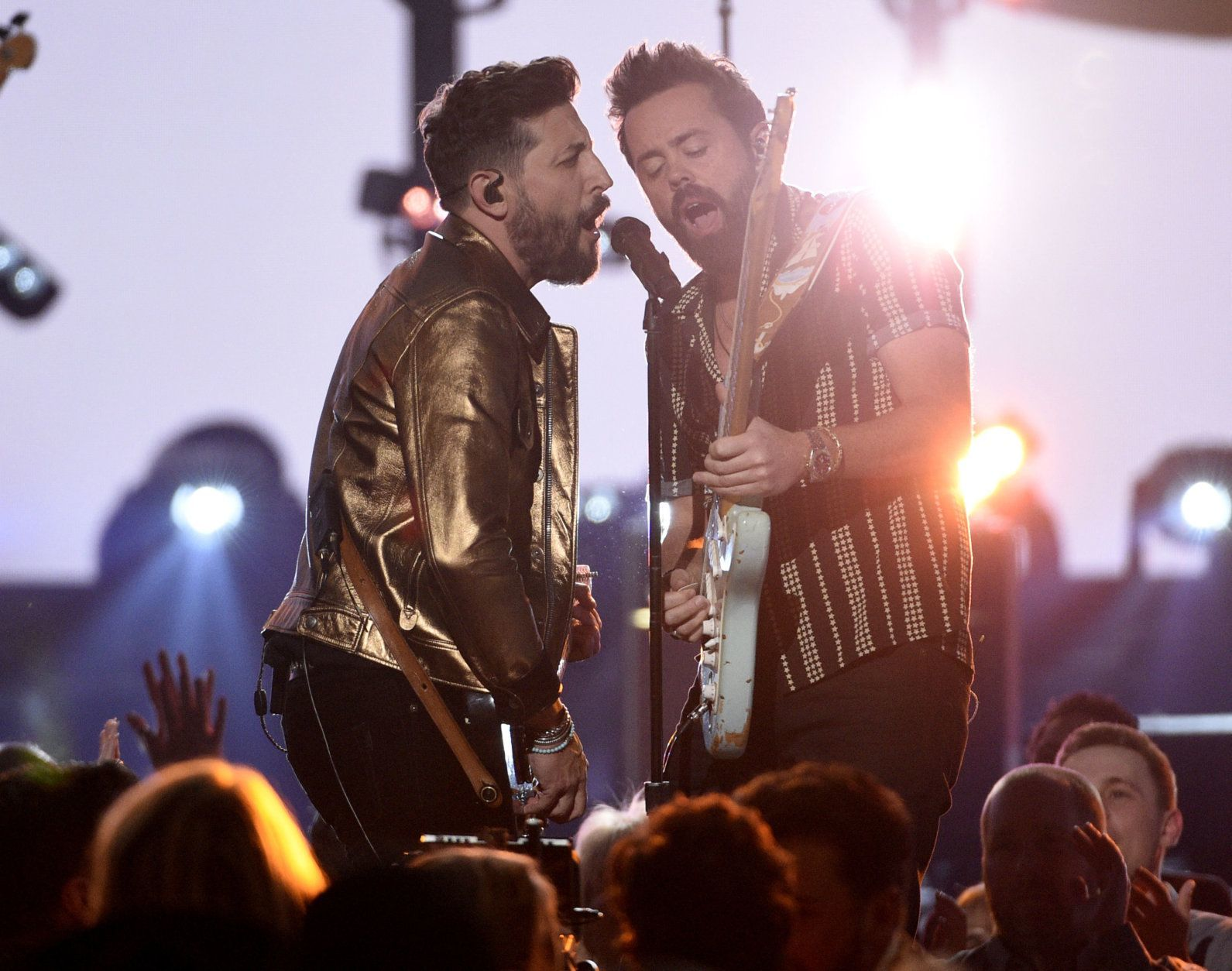 """Matthew Ramsey, left, and Brad Tursi, of Old Dominion, perform """"Make It Sweet"""" at the 54th annual Academy of Country Music Awards at the MGM Grand Garden Arena on Sunday, April 7, 2019, in Las Vegas. (Photo by Chris Pizzello/Invision/AP)"""