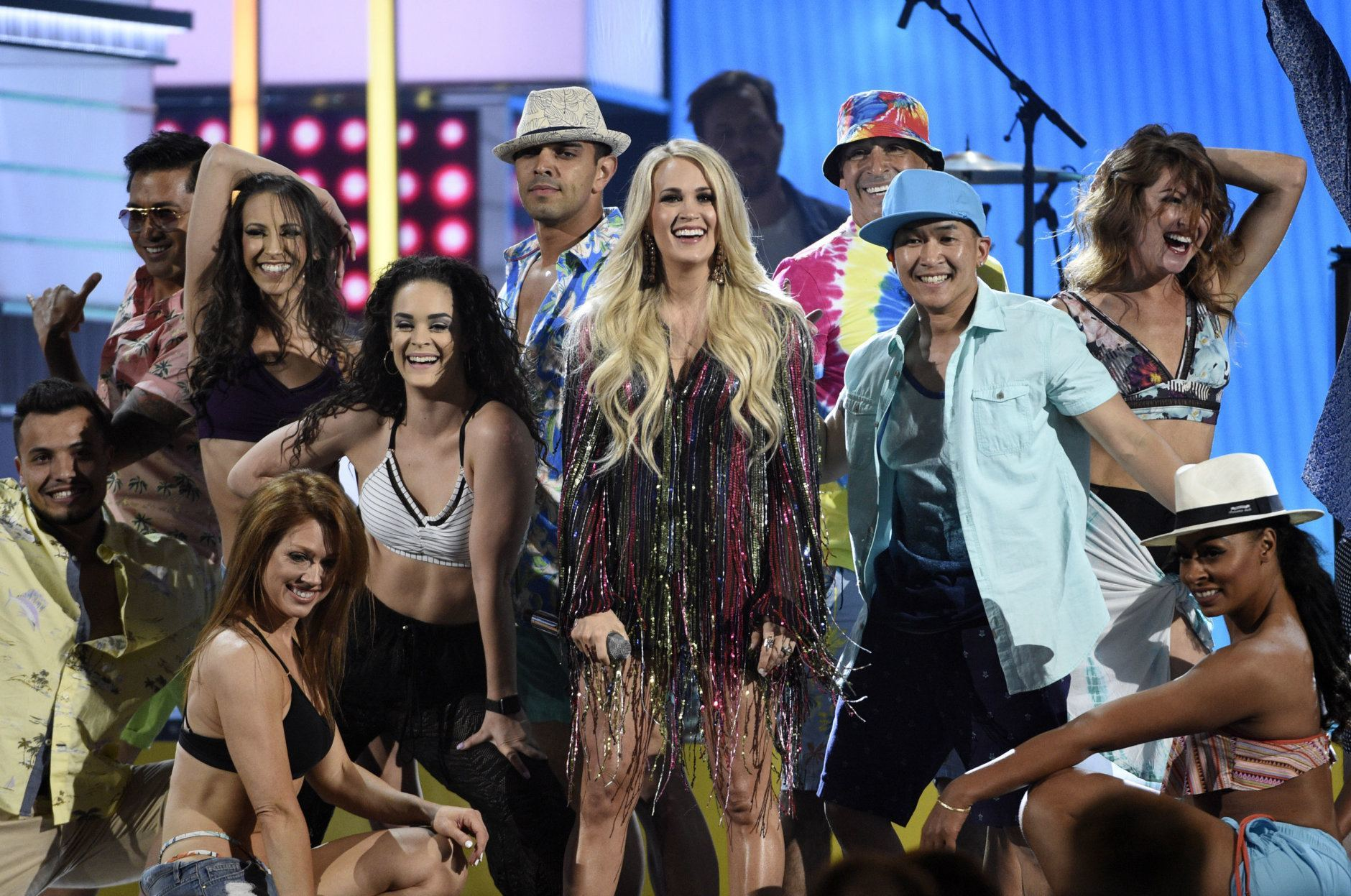 """Carrie Underwood, center, performs """"Southbound"""" at the 54th annual Academy of Country Music Awards at the MGM Grand Garden Arena on Sunday, April 7, 2019, in Las Vegas. (Photo by Chris Pizzello/Invision/AP)"""
