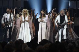 """Jimi Westbrook, from left, Kimberly Schlapman, Karen Fairchild and Philip Sweet, of Little Big Town, perform """"The Daughters"""" at the 54th annual Academy of Country Music Awards at the MGM Grand Garden Arena on Sunday, April 7, 2019, in Las Vegas. (Photo by Chris Pizzello/Invision/AP)"""