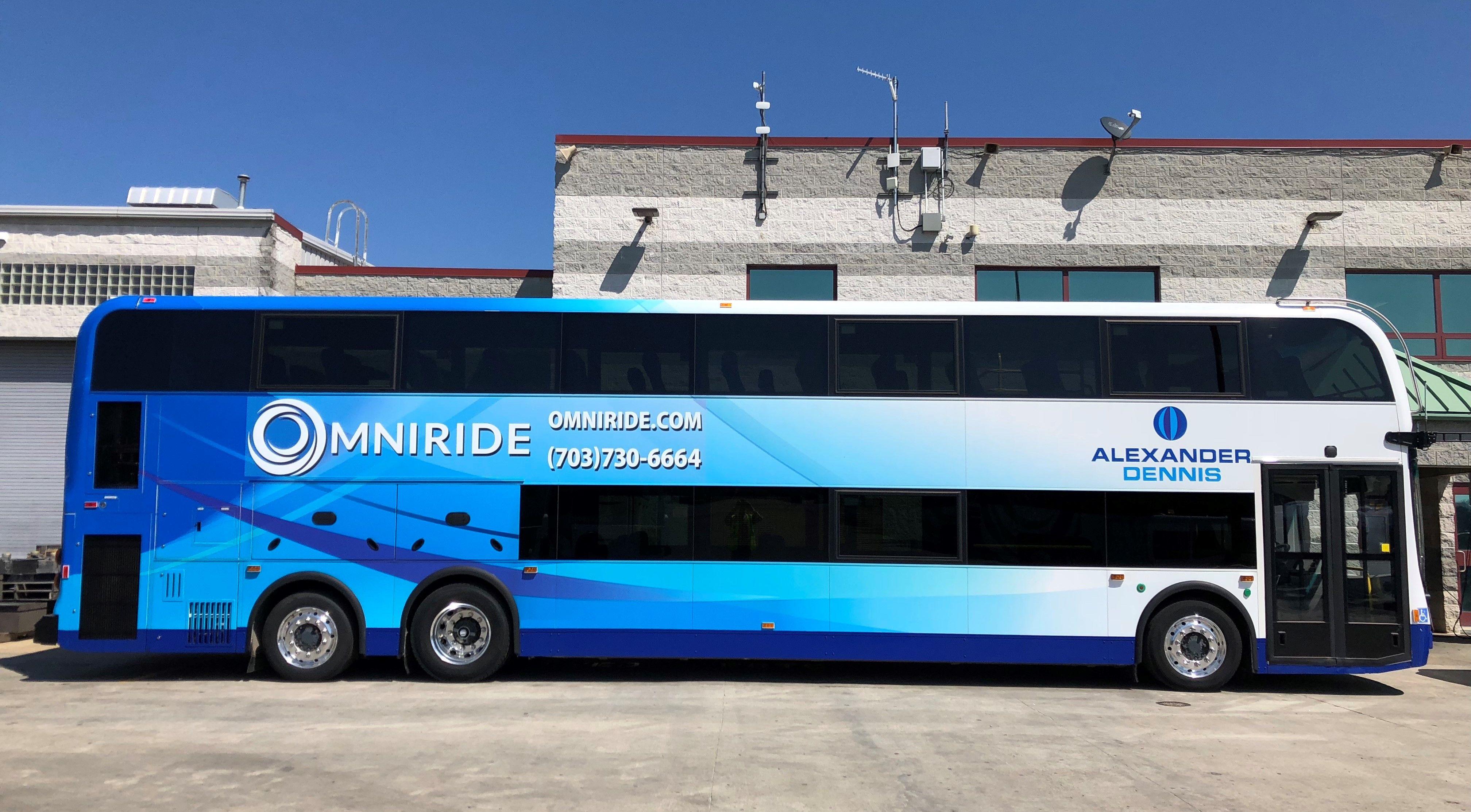 1st double-decker commuter bus rolling out onto DC-area