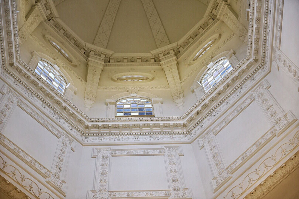 A look up into the rotunda at the Maryland State House. Construction of the State House was begun in 1772. The exterior of the dome does not have a single metal nail. The wooden dome is fitted together with wooden pegs and iron bands. (WTOP/Kate Ryan)