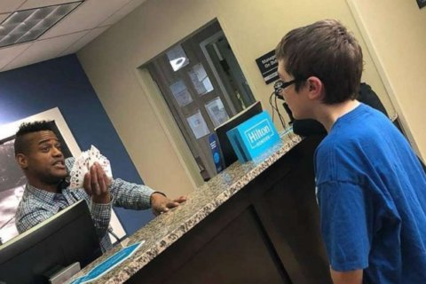 Card tricks turn hotel worker and boy with autism into fast friends