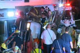 Emergency workers are seen on the scene at the Sheriff Road crash. (Courtesy NBC Washington)