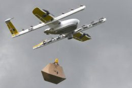 In this Tuesday, Aug, 7, 2018, photo a Wing Hummingbird drone carries a package of ice cream and popsicles as it leaves its launch site during a delivery flight demonstration in Blacksburg, Va. Wing, a subsidiary of Google's parent corporation Alphabet, hasn't been allowed to fly long distances, over people and beyond the pilot's line of sight. That changed when Virginia was selected as one of 10 areas to participate in an experimental program that would lower barriers on the technology. (Michael Shroyer via AP)