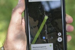 In this Tuesday, Aug, 7, 2018, photo a detailed view of the website that will be used by consumers to monitor and learn about drones they may see or hear nearby is displayed in Blacksburg, Va. Wing, a subsidiary of Google's parent corporation Alphabet, hasn't been allowed to fly long distances, over people and beyond the pilot's line of sight. That changed when Virginia was selected as one of 10 areas to participate in an experimental program that would lower barriers on the technology. (Michael Shroyer via AP)