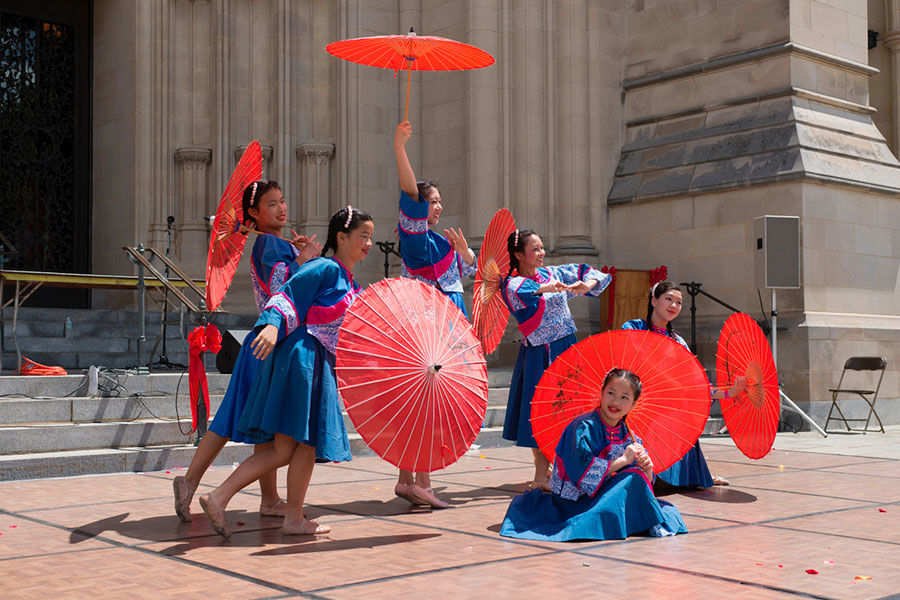Dancers and singers entertain visitors at the Washington National Cathedral's Flower Mart. (Courtesy All Hallows Guild)