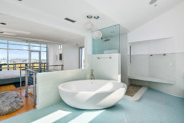 The bathroom of one of the master suites has a 600 pound tub and a rain shower. (Courtesy Svetlana Leahy)