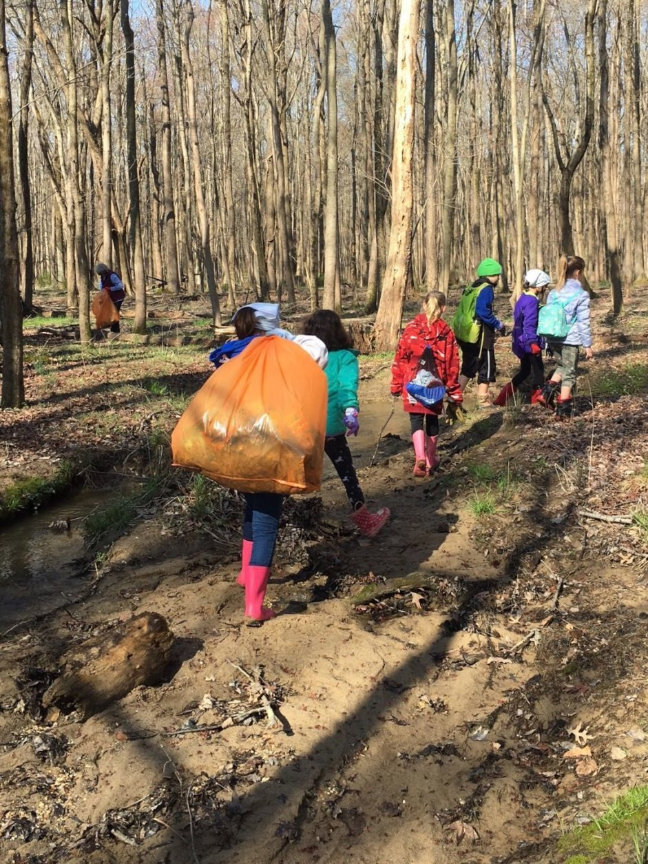 Girl Scout Troops 52014 and 3446 from Springfield VA collected 9 bags of trash in and around a stream at Huntley Meadows. The scouts were taking part in April's month long clean ups, a joint effort between the Nature Conservancy and the Fairfax Park Authority. (Courtesy Nature Conservancy/ Kelley Galownia)
