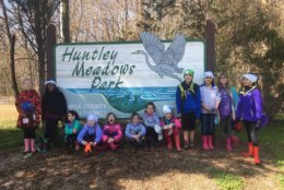 Girl Scout troops 52014 and 3446 from Springfield, Virginia, collecting trash in and around a stream at Huntley Meadows Park in Fairfax County. (Courtesy Nature Conservancy/Kelley Galownia)