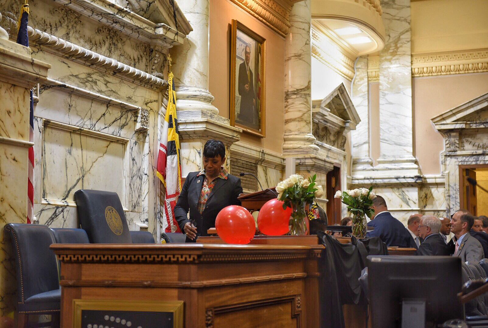 "Speaker Pro Tem Adrienne Jones filled in for House Speaker Michael Busch while he was out with pneumonia. He died Sunday, so then Jones had to fill his shoes for the end of the session, declaring the legislative session at an end with the words ""sine die."" The balloons are a tradition, released from balconies above the Speaker's lectern. (WTOP/Kate Ryan)"