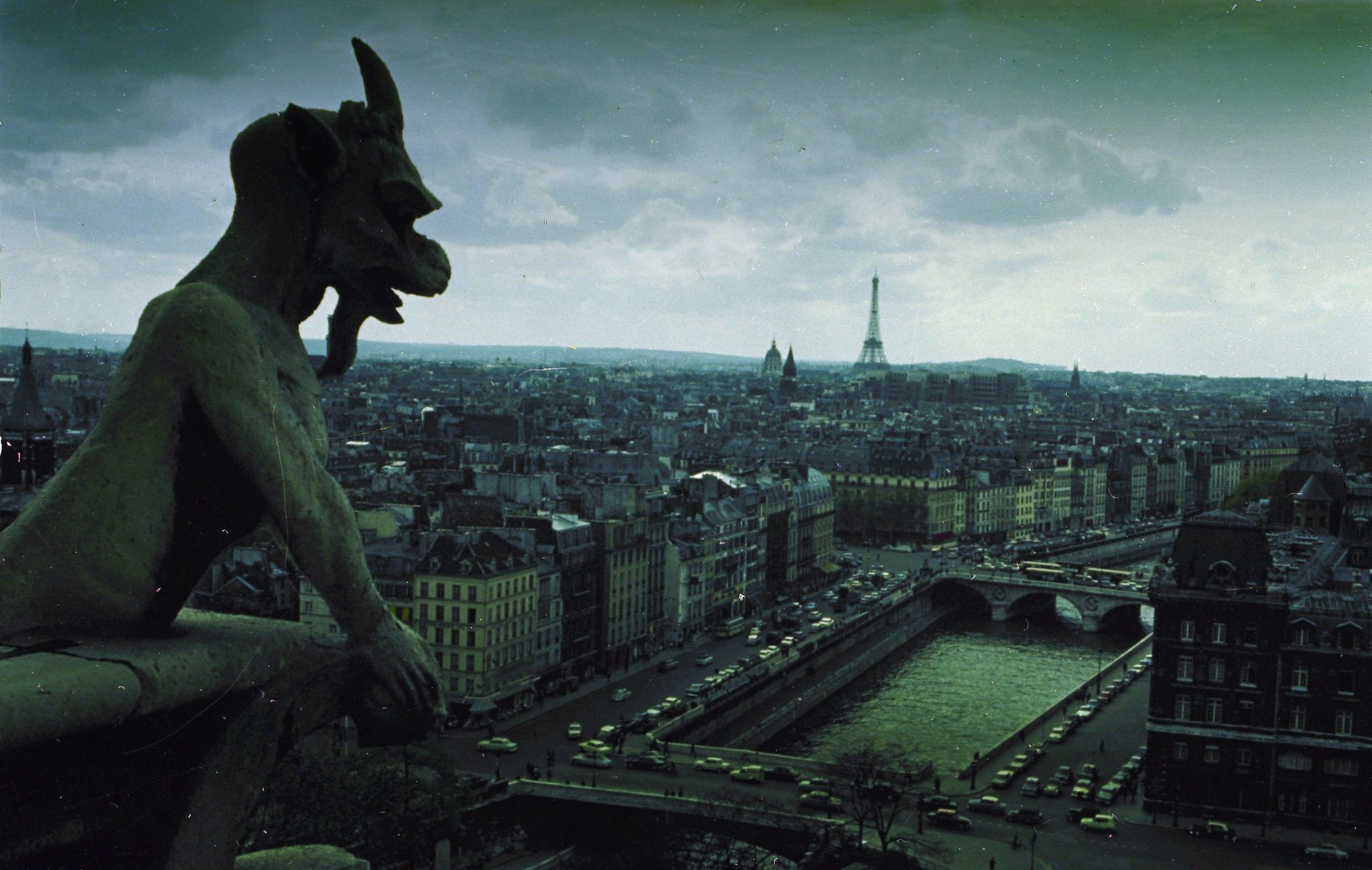 A Notre Dame gargoyle looks over the city of Paris, Dec. 1966.  In the background is the Eiffel Tower.  (AP Photo)
