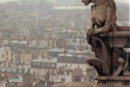 A chimera and a gargoyle watch over Paris from the top of the 11th century Notre Dame cathedral, Jan. 10, 1996. Architect Viollet le Duc added the chimeras and gargoyles to the tower walls when repairing the damages caused by the French Revolution. The chimeras are purely decorative while the garoyles were built to serve as raingutters. (AP Photo/Remy De La Mauviniere)