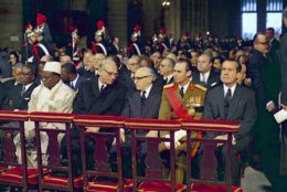 The funeral of former French President Charles De Gaulle at Notre-Dame Cathedral, Paris, France, on Nov. 12, 1970, was attended by many heads of state and members of European Royal families. President of the United States, Richard Nixon, sits right before the start of the service. (AP Photo)
