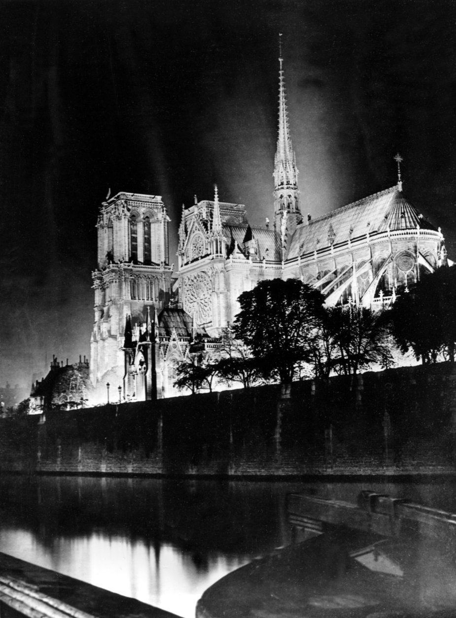 This is a nighttime view of the Cathedral of Notre Dame, Our Lady, on the island called Ile de la Cite in Paris, France, in 1933.  (AP Photo)