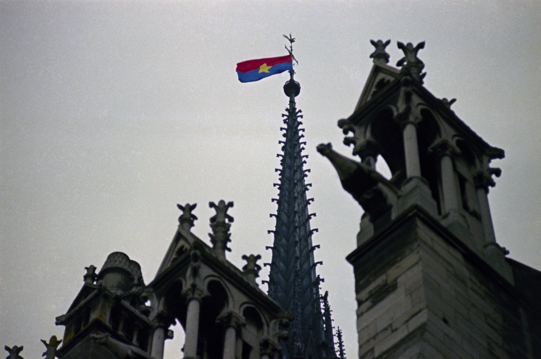 A North Vietnam flag flies from the pinnacle of Notre Dame Cathedral in Paris, France on Jan. 19, 1969 as peace talks on a possible cease-fire in Vietnam had started on previous day. (AP Photo)