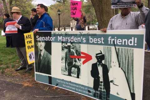 'The outrage stays:' Protesters at Va. fundraiser haven't forgotten Northam racist photo scandal