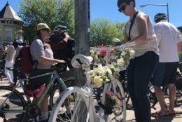 Mourners leave a ghost bike in memory of David Salovesh, who died on Florida Avenue in Northeast D.C. (WTOP/Melissa Howell)