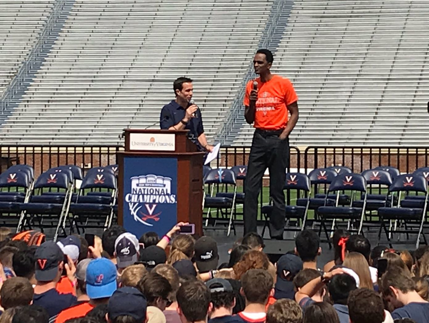 Virginia men's basketball coach Tony Bennett, left, introduces Ralph Sampson, who was part of the team that first made it to the Final Four, during a celebration in Charlottesville on Saturday, April 13, 2019. (WTOP/Michelle Basch)