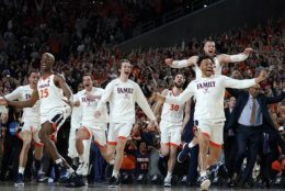 Virginia players celebrate after defeating Texas Tech 85-77 in the championship game of the Final Four NCAA college basketball tournament, Monday, April 8, 2019, in Minneapolis. (AP Photo/David J. Phillip)